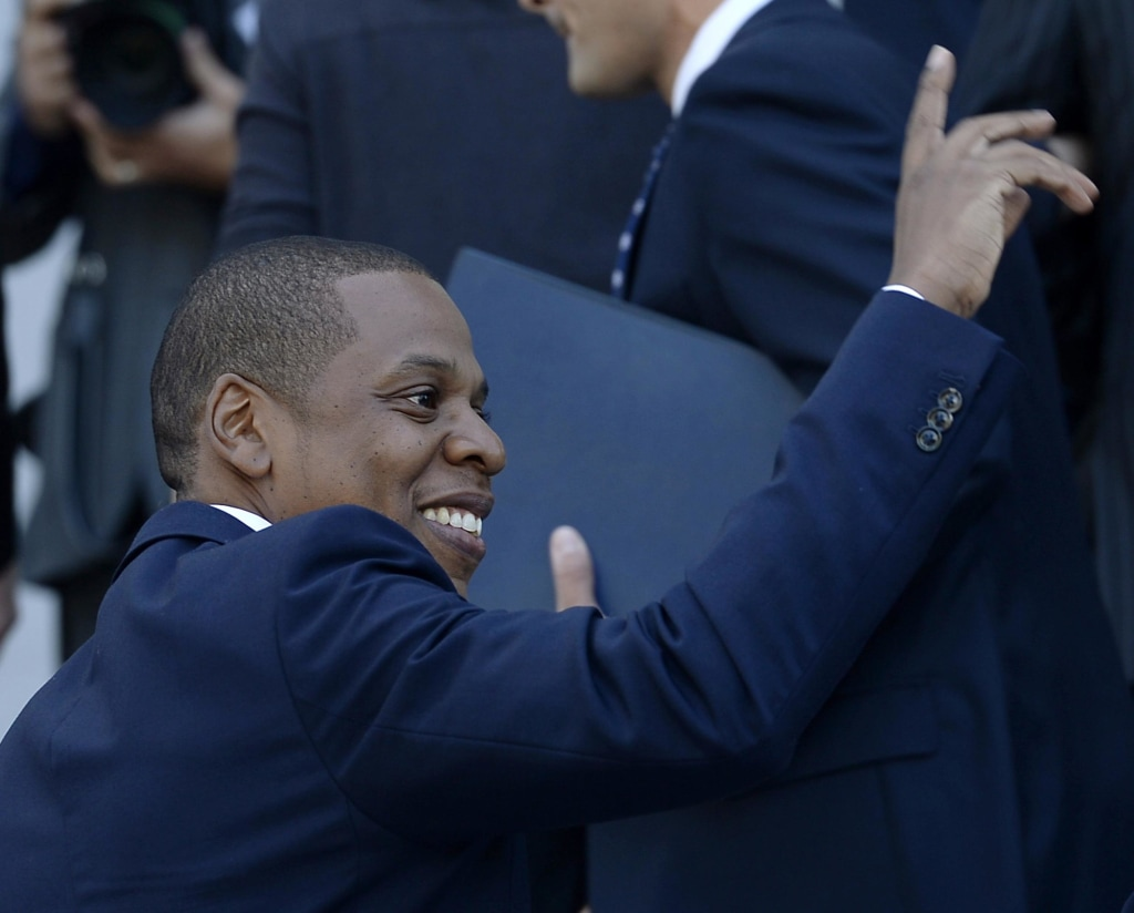 "Image: Rapper Jay-Z acknowledges a fan during a news conference after announcing his two-day ""Made in America"" music festival with Los Angeles Mayor Eric Garcetti, in Los Angeles"
