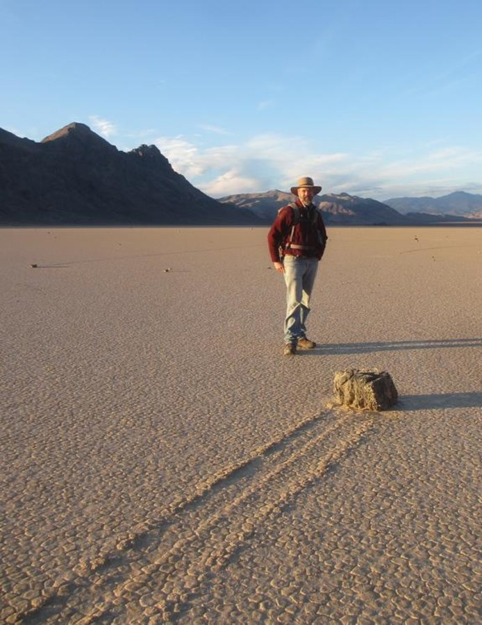 Image: Biologist Richard Norris stands next to a Racetrack Playa rock trail