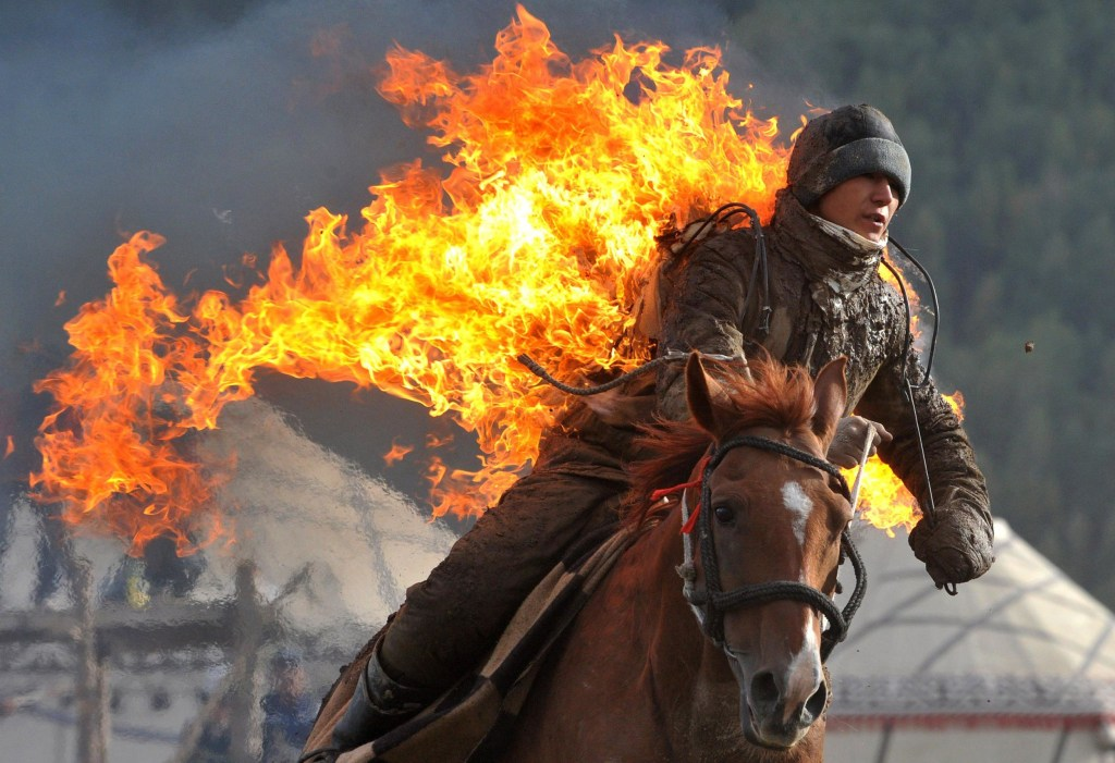Image: A Kyrgyz stuntman performs during the first World Nomad Games in the Kyrchin (Semenovskoe) gorge, some 300 km from Bishkek on Sept. 10.
