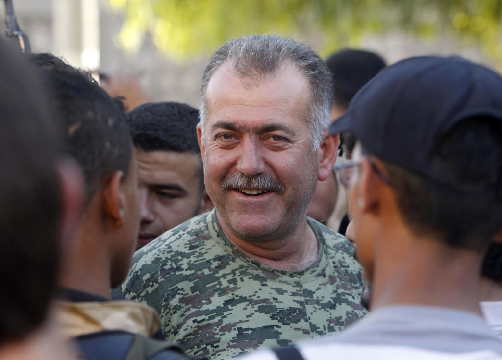 Colonel Abdul-Jabbar al-Aqidi, commander of the rebels' Military Council in Aleppo, is seen among members of Ghurabaa al-Sham brigade in the Al-Sakhour neighborhood of Aleppo