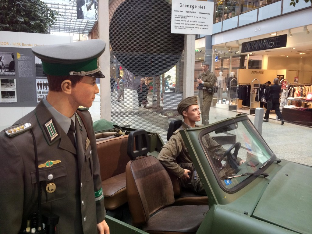 Image: Mannequins representing East German border guards at an exhibit in a shopping mall in Berlin.