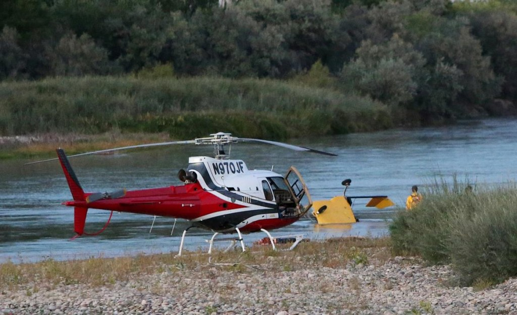 Image: A yellow, two-seat helicopter crashed into the Colorado River Saturday evening
