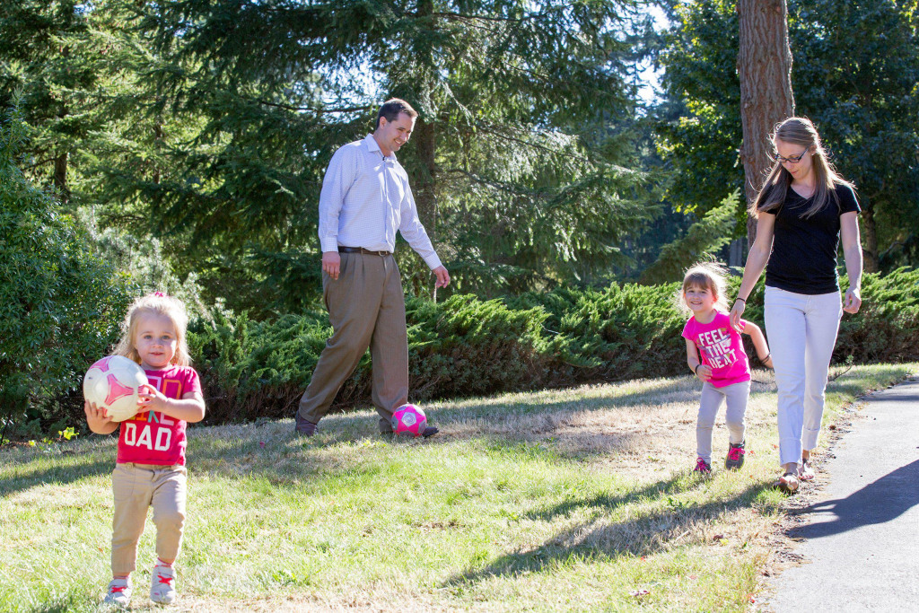 Image: Casey Sullivan, left, plays soccer at home with his daughters Raegan, 2, and Taylor, 4.