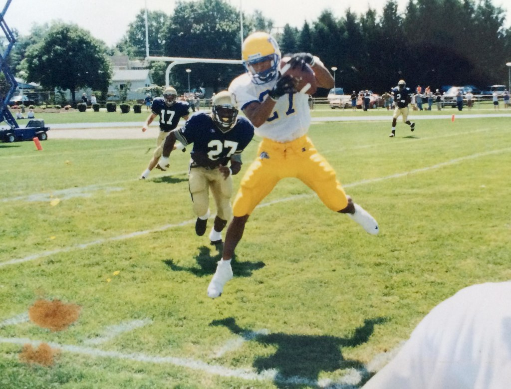 Image: Mike Clark 1993 Sayreville H.S. graduate, catches a pass during a game.