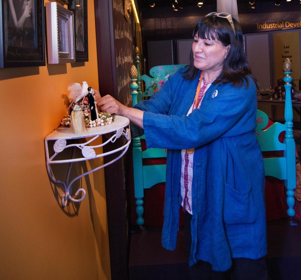 Image: Author Sandra Cisneros prepares a Dia De Los Muertos altar