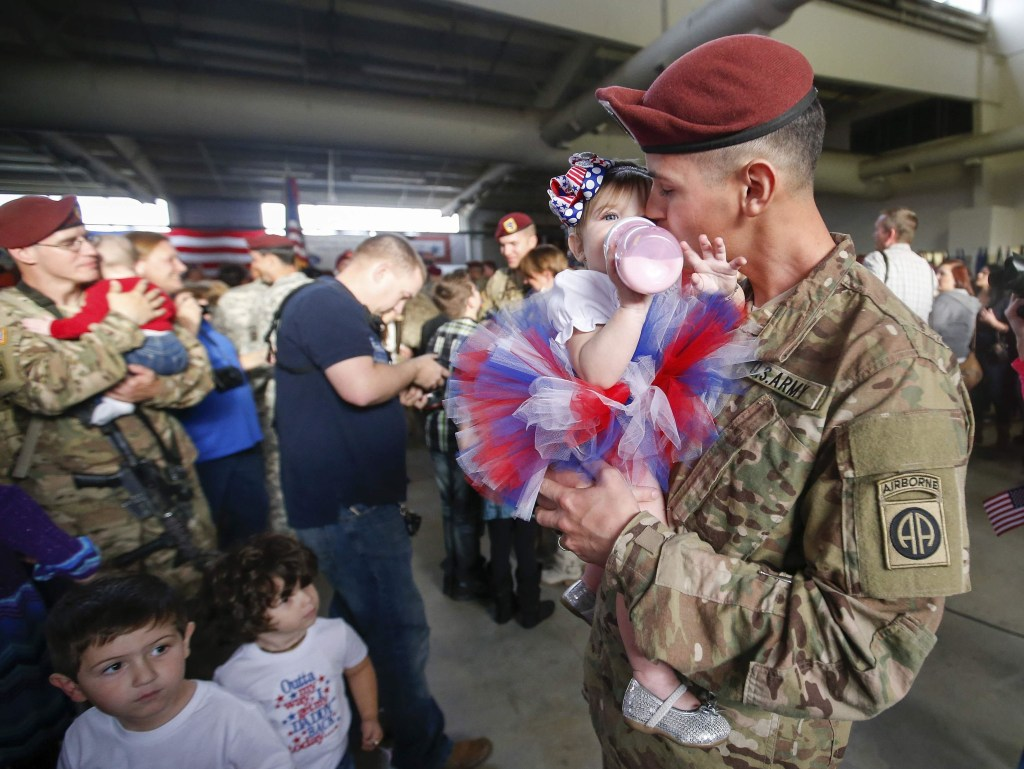 Image: A paratrooper kisses his daughter after returning home from Afghanistan at Pope Army Airfield in Fort Bragg, North Carolina