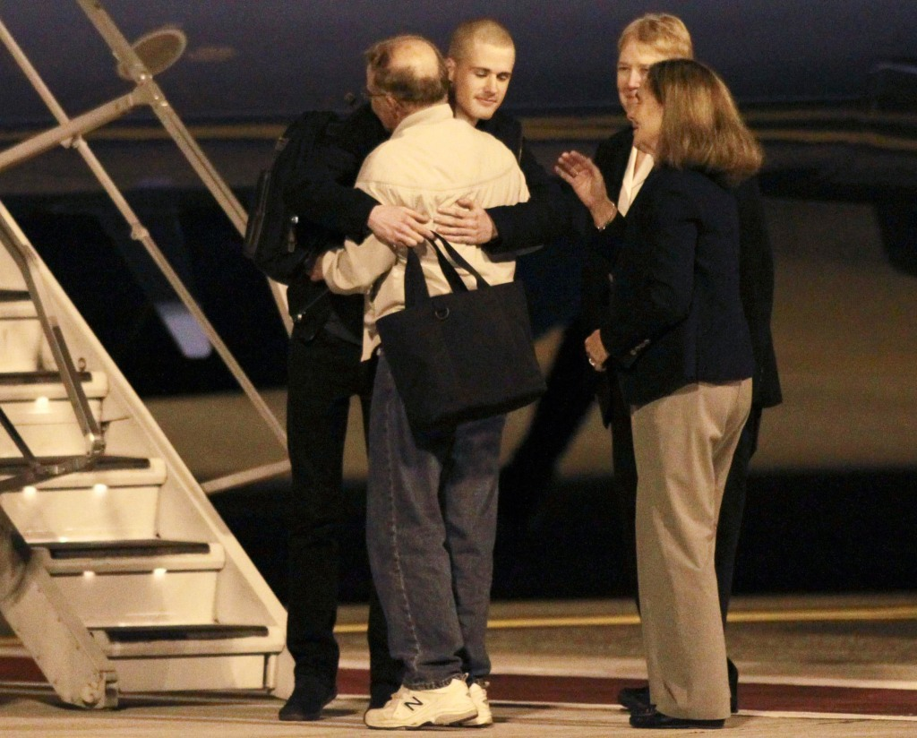 Image: American Matthew Todd Miller reunites with his family upon returning to the U.S. along with fellow prisoner Kenneth Bae at McChord Field at Joint Base Lewis-McChord,Washington