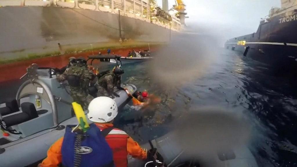 Image: Spanish Navy members rescue Greenpeace member