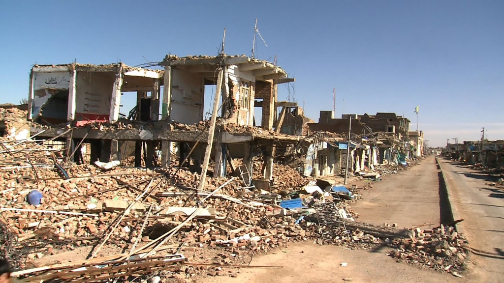 Bombed-out houses, buildings pocked with bullet holes and craters line the streets of Mir Ali, in Pakistan's Waziristan region.