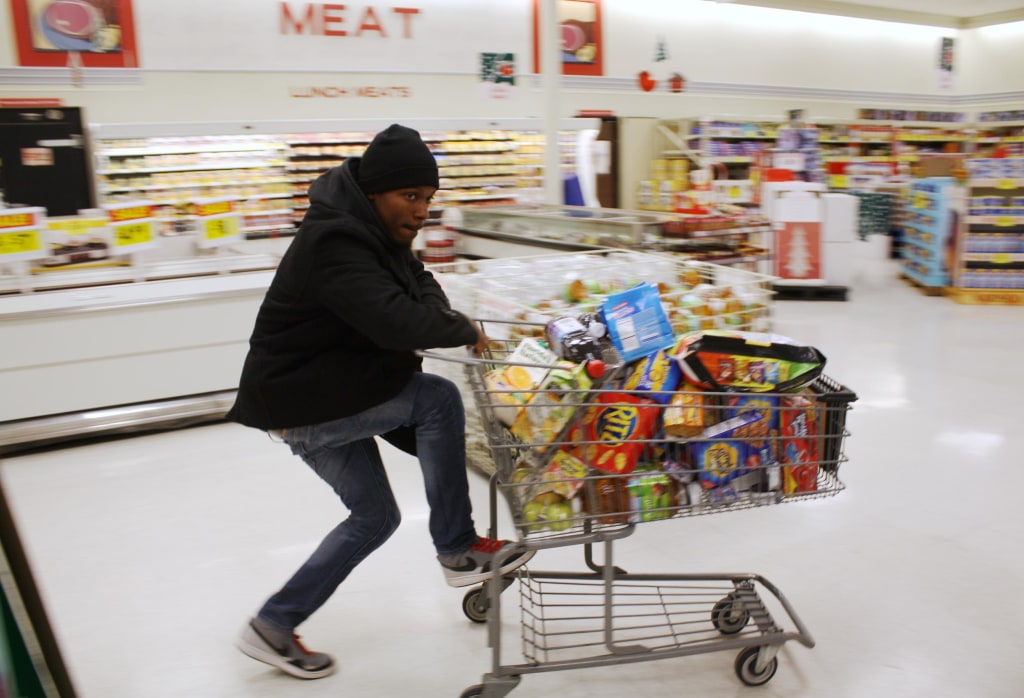 Image: Ferguson resident D. Hampton, a pseudonym, goes shopping at a local grocery store