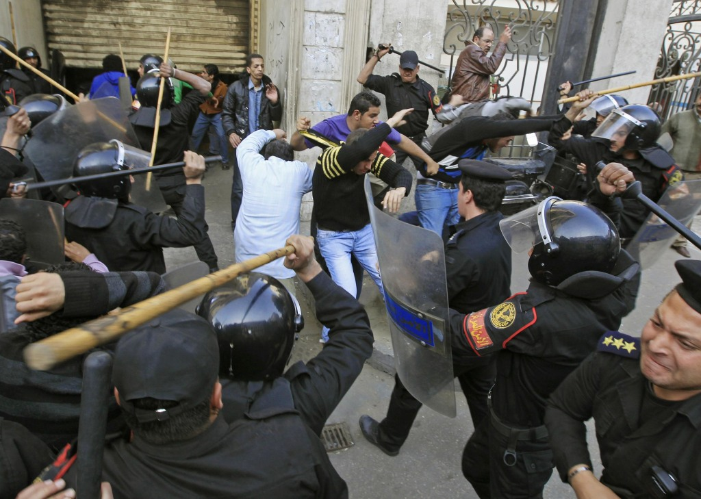 Image: Riot police clash with protesters in Cairo