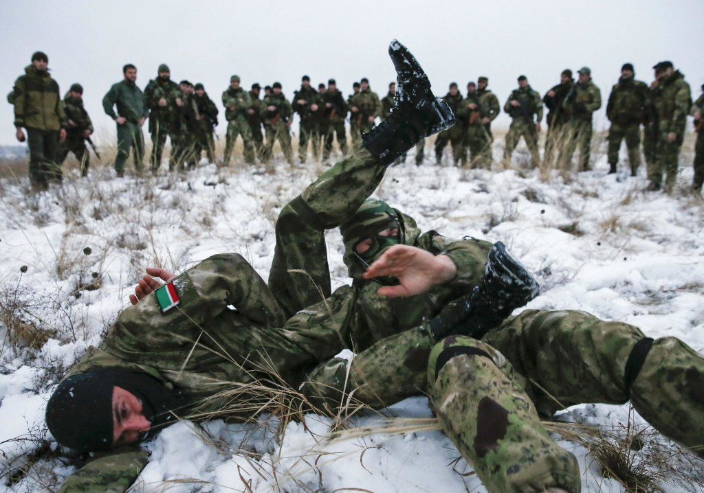 """Image: Pro-Russian separatists from the Chechen """"Death"""" battalion take part in a training exercise in the territory controlled by the self-proclaimed Donetsk People's Republic"""