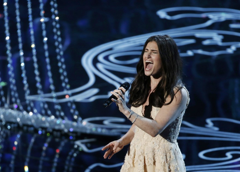 """Image: Menzel performs nominated original song """"Let it Go"""" by Lopez and Anderson-Lopez, for the film """"Frozen"""" at the 86th Academy Awards in Hollywood"""