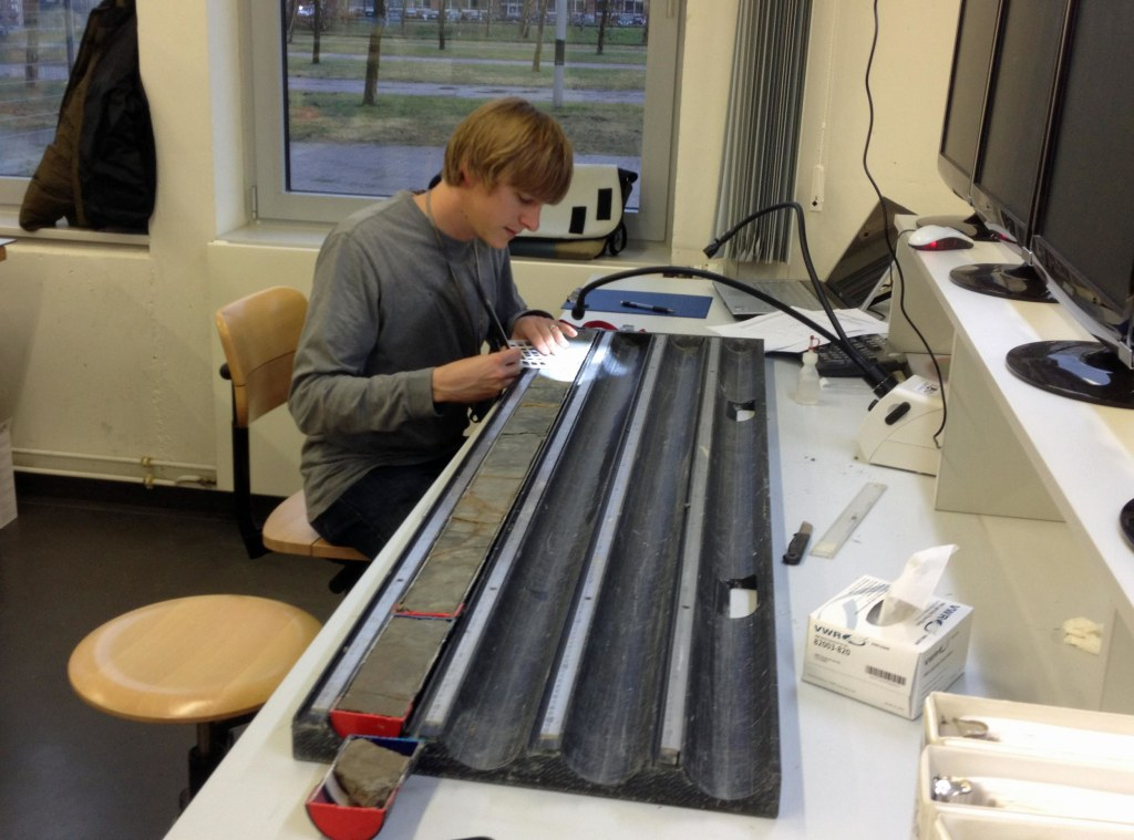 Image: University of Utah geochemist Gabriel Bowen works on Wyoming sediment cores