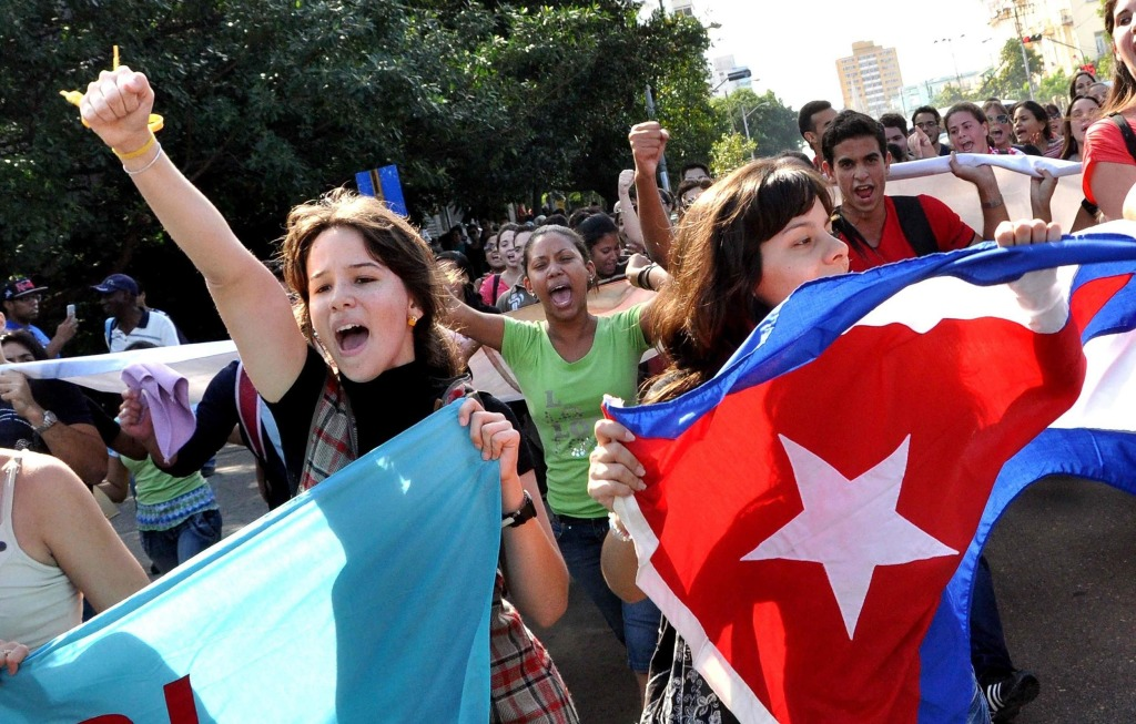 Image: Cuban students march in a street of Havana