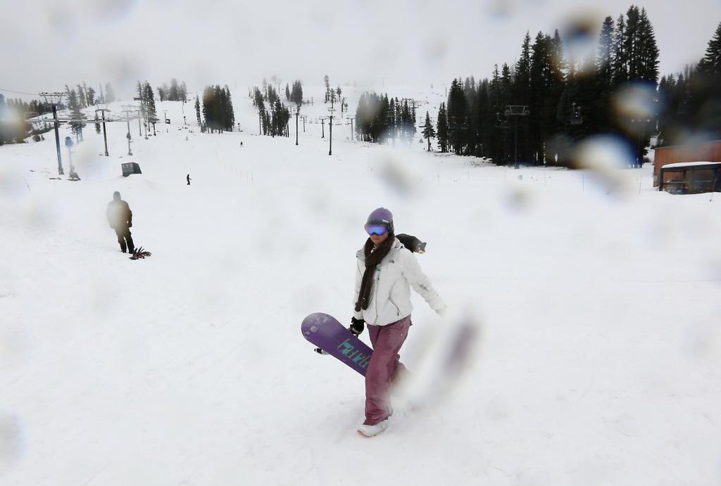 Image: Katie McGlothern, 25, leaves the slopes as rain begins to fall at the Boreal Mountain Ski Resort