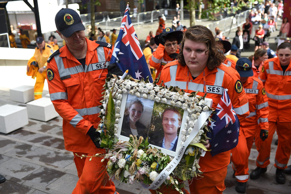 Image: Flowers and tributes are removed from memorial