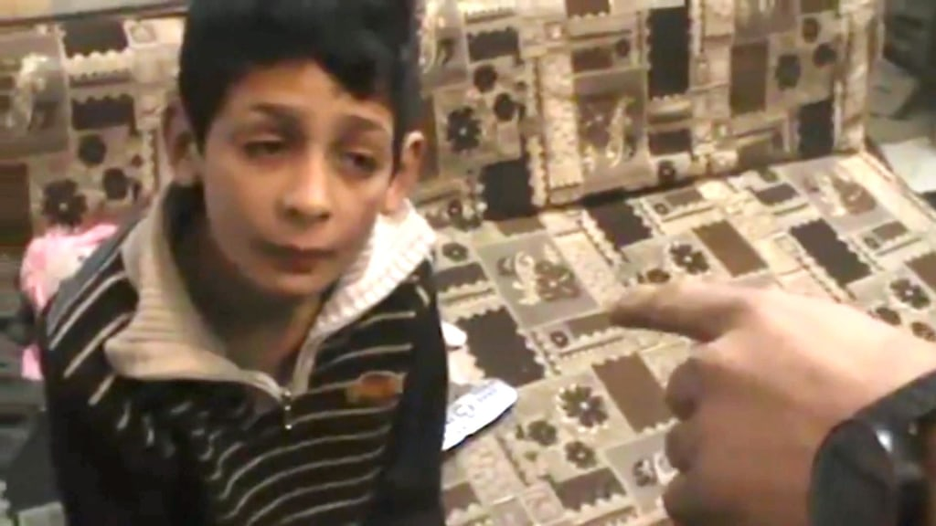 Image: Still from video provided by Israeli human rights organization B'Tselem shows a Palestinian boy being questioned by Israeli forces in the occupied West Bank on February 25.