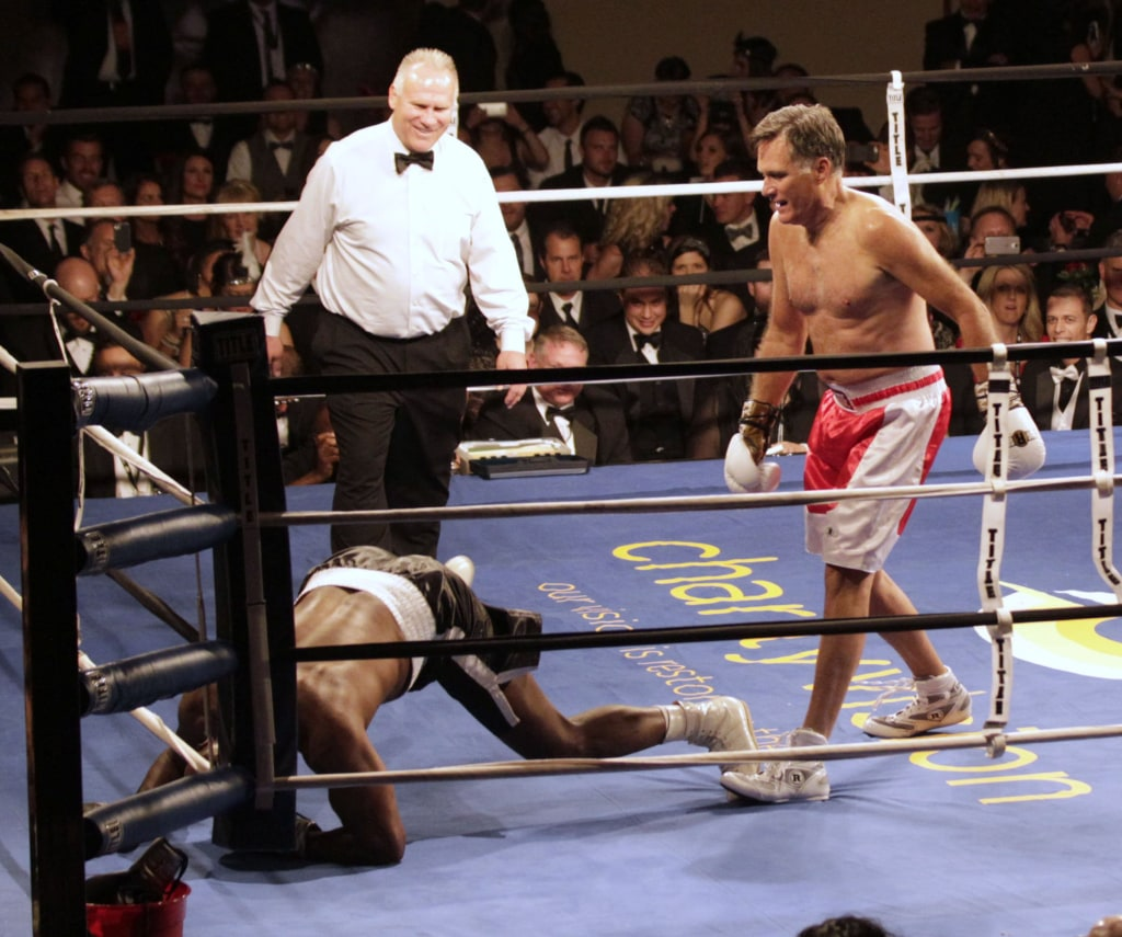 Image: Mitt Romney Takes On Evander Holyfield In Charity Boxing Event
