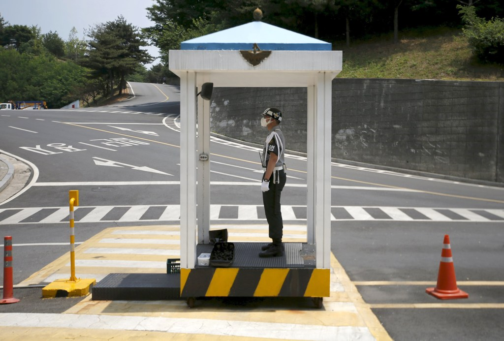 Image: A military policeman wearing a mask as a precaution against contracting MERS