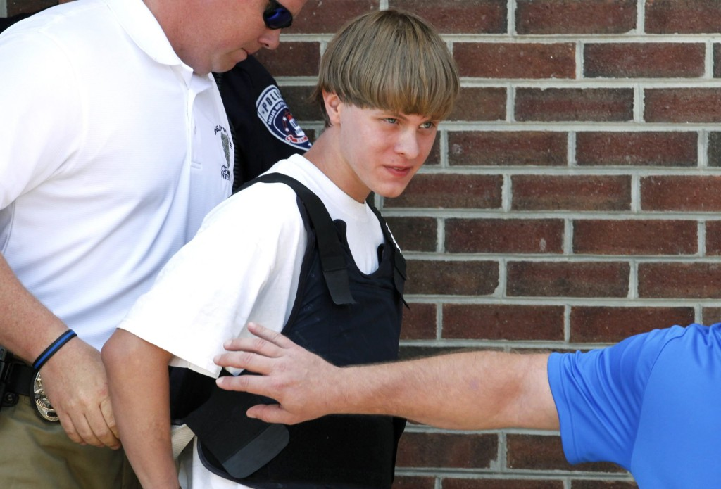 Image: Police lead suspected shooter Dylann Roof into the courthouse in Shelby, North Carolina