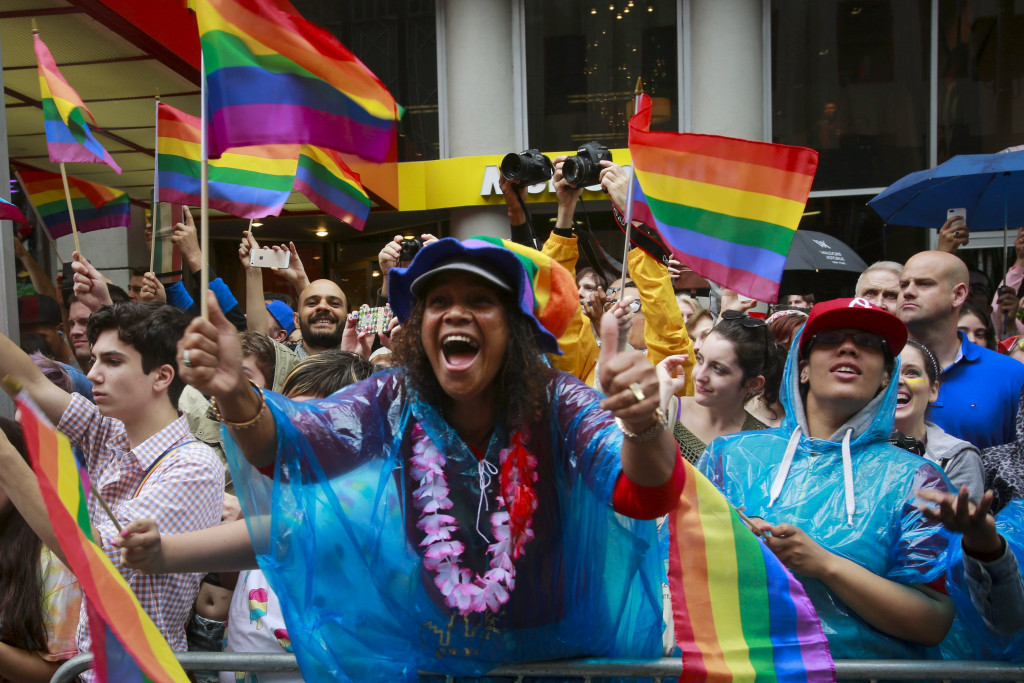 Image: Spectators cheer marchers during the annual Gay Pride parade in New York