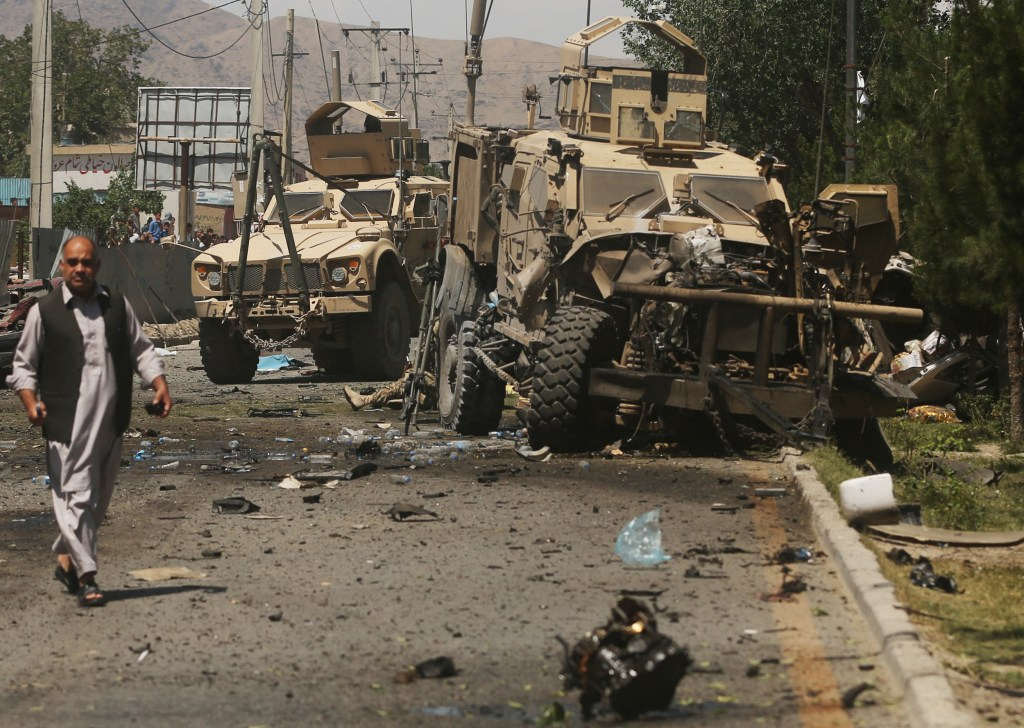 Image: A destroyed armored vehicle remains at the site of a blas