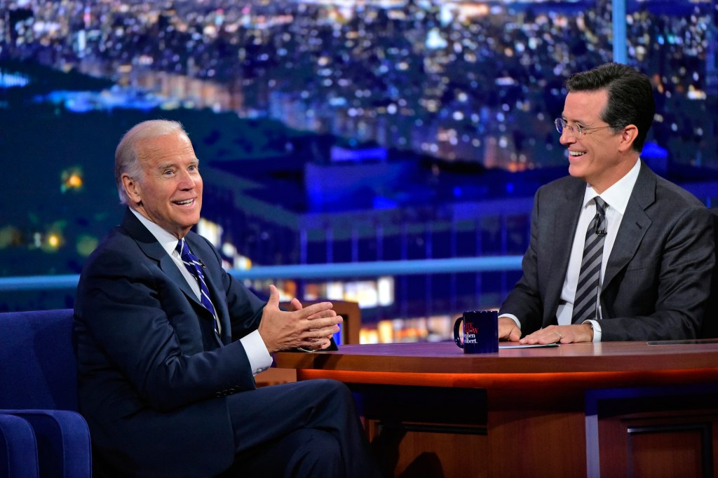 Image: Stephen Colbert talks with Vice President Joe Biden