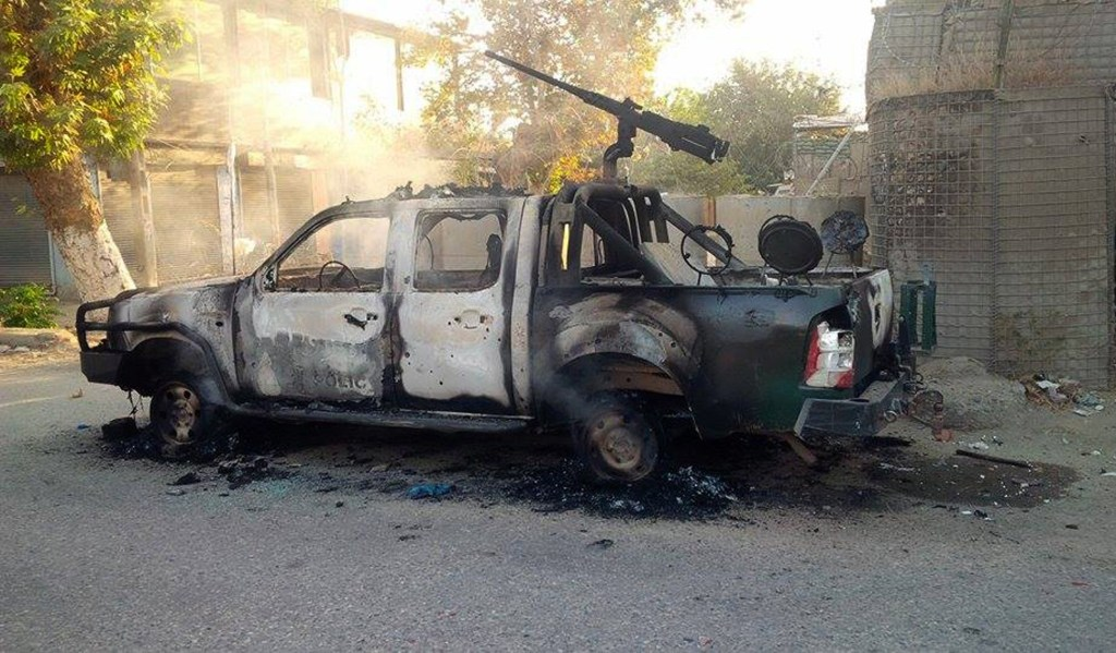 Image: Burnt-out truck in Kunduz on Thursday