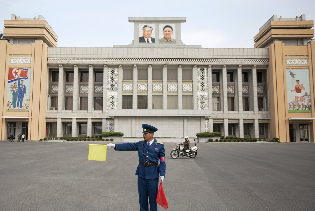 Image: A policeman directs traffic at Kim Il Sung Stadium before North Korea's preliminary 2018 World Cup and 2019 AFC Asian Cup qualifying soccer match against Philippines in Pyongyang