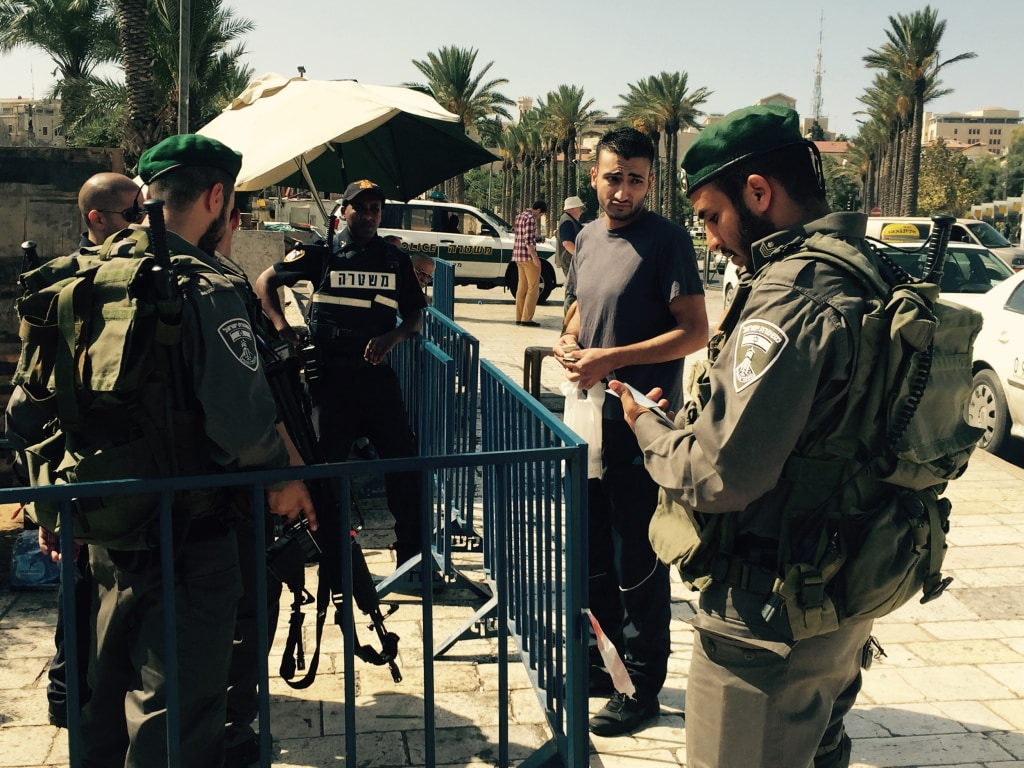 Image: Israeli security forces check ID cards at Damascus Gate in Jerusalem