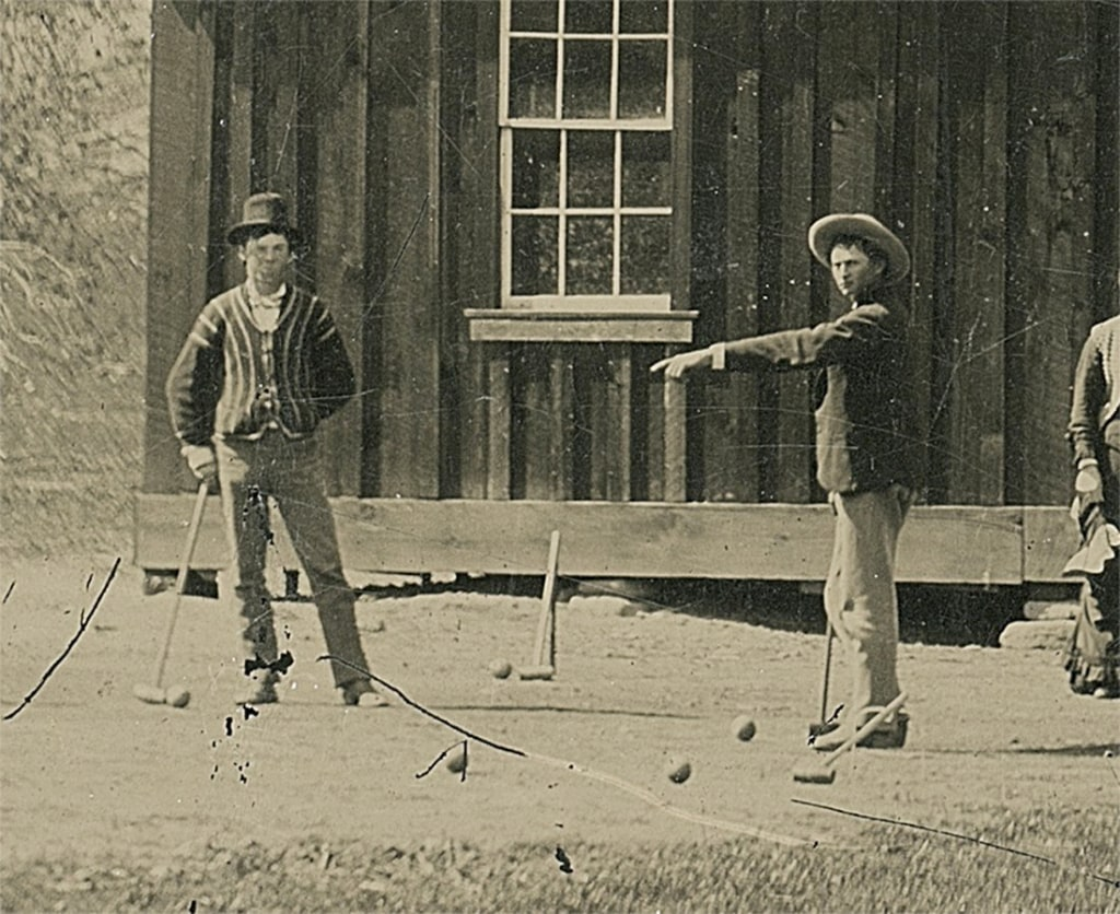 Image: Close-up of a newly discovered 4-by-5-inch tintype photograph shows legendary Wild West gunslinger Billy the Kid playing croquet with accomplices from his New Mexico gang known as the Regulators