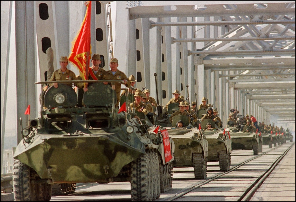 Image: A convoy of Soviet Army armored personnel vehicles leave Afghanistan in May 1988