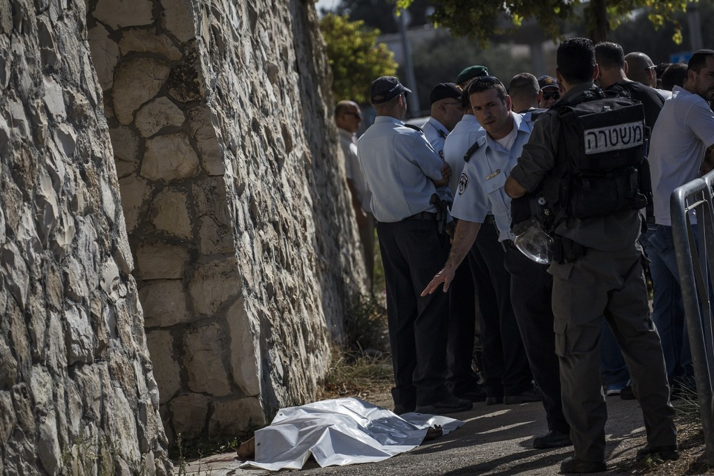 Image: Body of Palestinian man at site of a stabbing in Jerusalem on Saturday