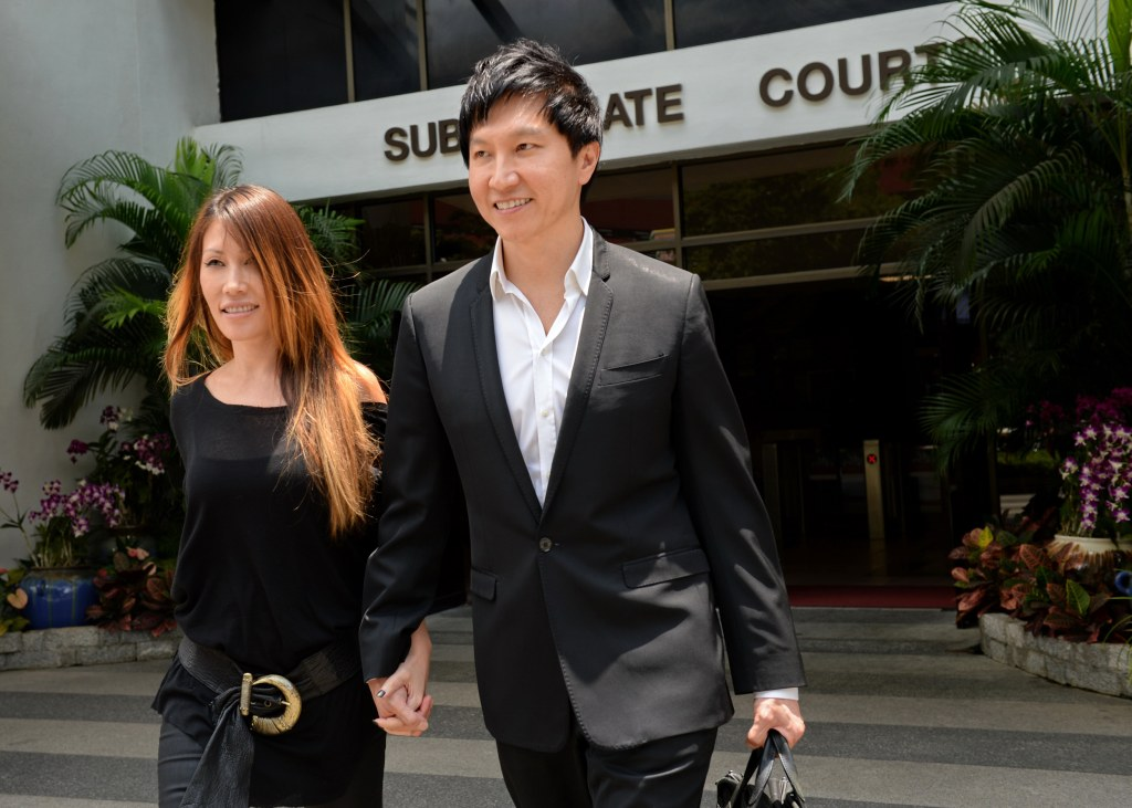 Image: City Harvest Church founder Kong Hee (R) with his pop-singer wife Ho Yeow Sun