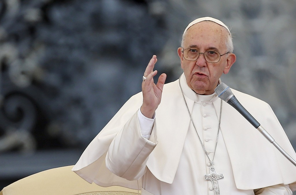 Image: Pope Francis blesses the faithful during his Wednesday general audience in Saint Peter's square at the Vatican
