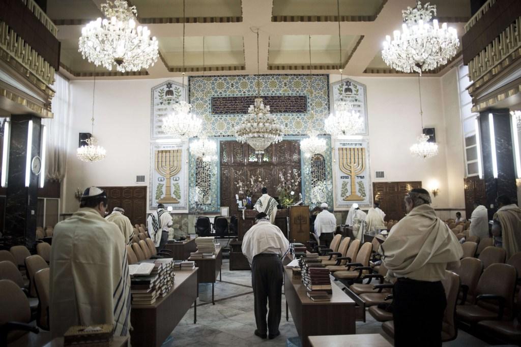 Image: Iranian Jewish men during morning prayers