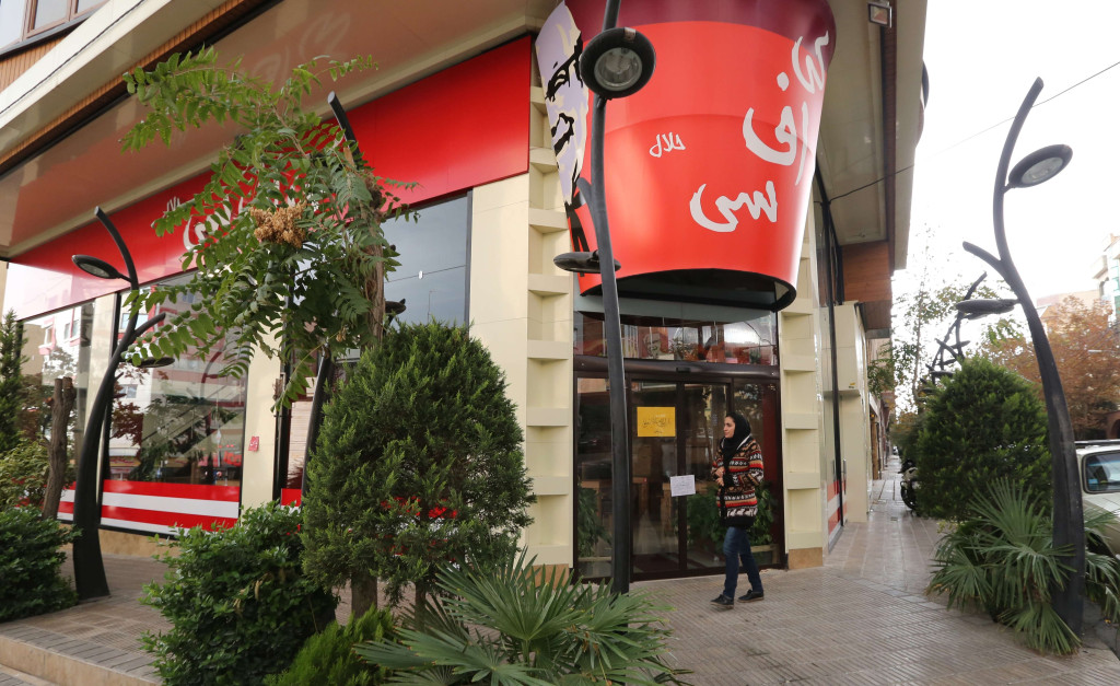 """Image: Woman walks past Halal KFC"""""""