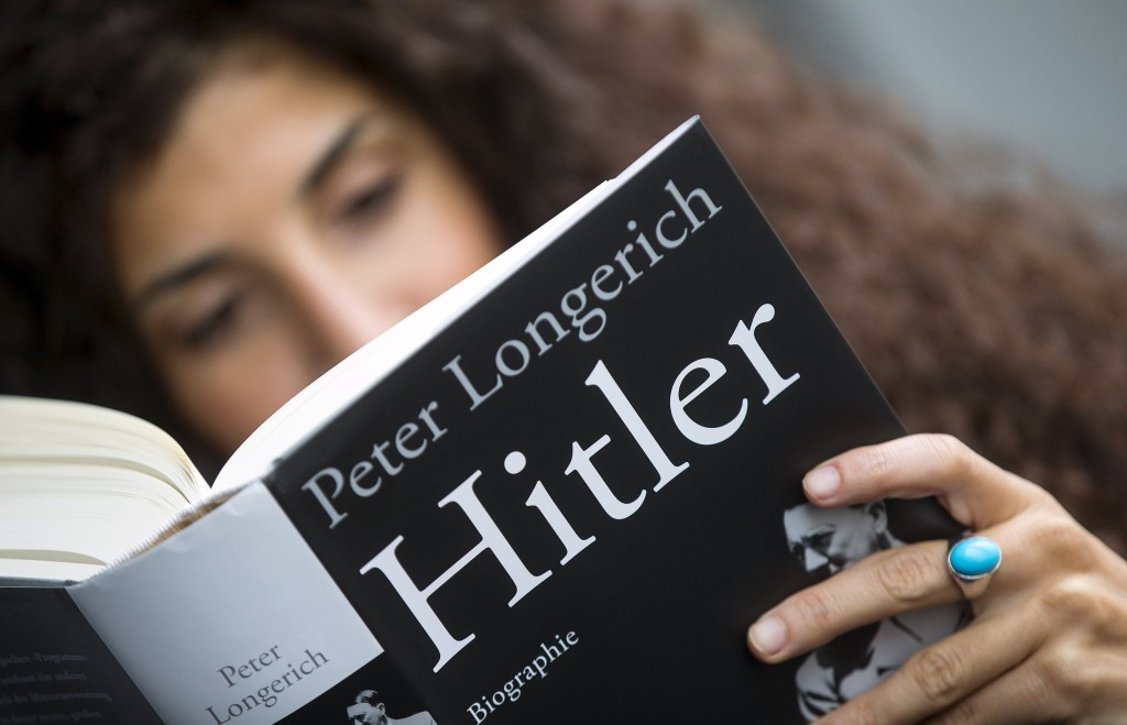"Image: A woman reads Peter Longerich's new book ""Hitler"" in Berlin"