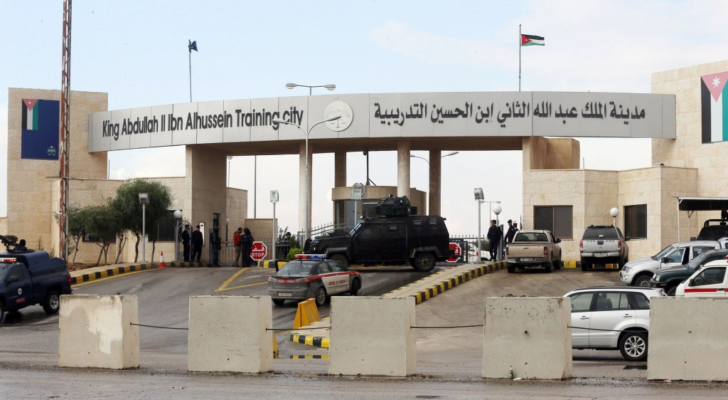 Image: Additional anti-terrorism forces are seen guarding the entrance of King Abdullah Bin Al Hussein Training City