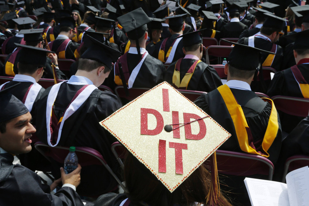 "Image: Graduating student has ""I Did It"" written on her mortar board during Commencement Exercises at Boston College"