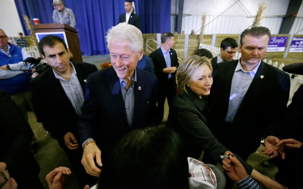 Image: Hillary Rodham Clinton and Bill Clinton greet supporters at the Central Iowa Democrats Fall Barbecue