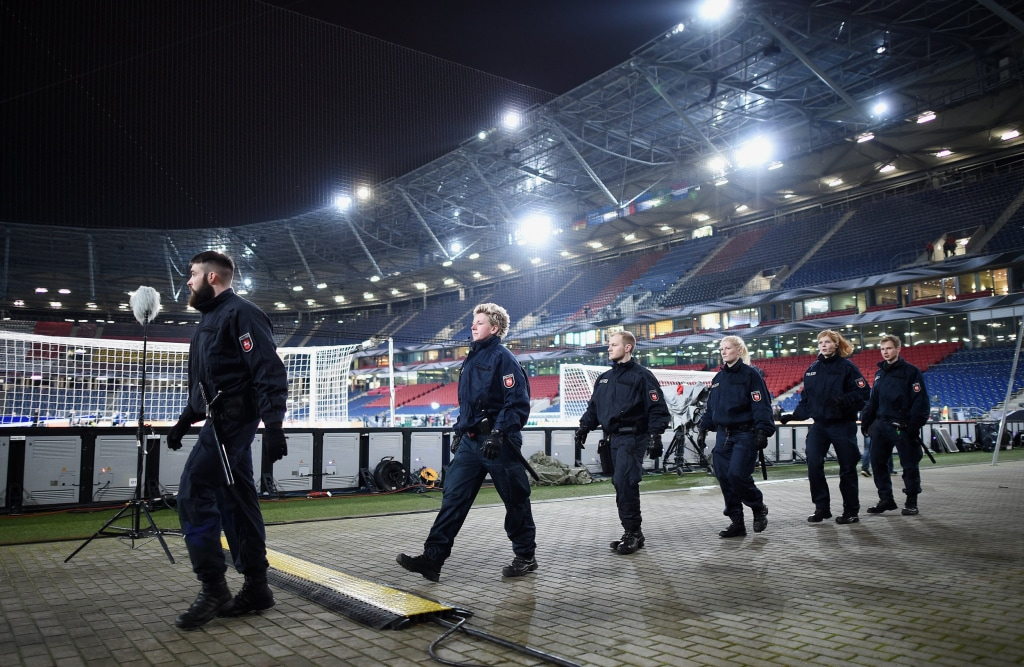Image: Police forces secure the infield of the HDI-Arena prior the International Friendly match