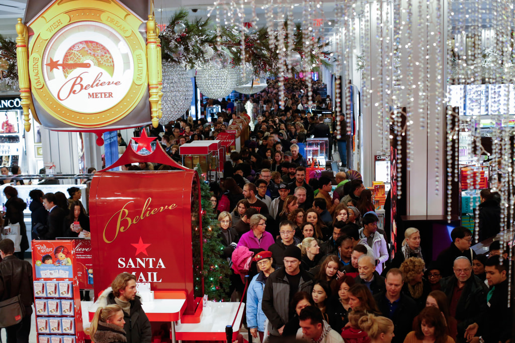 Image: Customers stream into Macy's flagship store