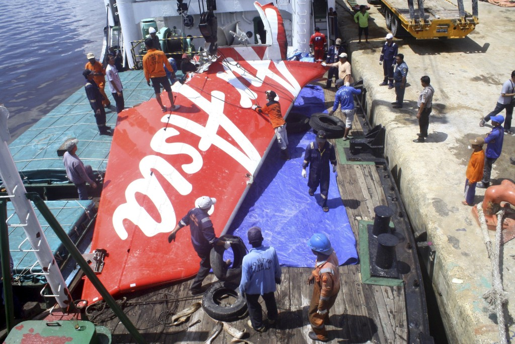 Image: File photo of a section of AirAsia flight QZ8501's tail being loaded onto a boat for transportation to Jakarta from Kumai Port, near Pangkalan Bun, Central Kalimantan