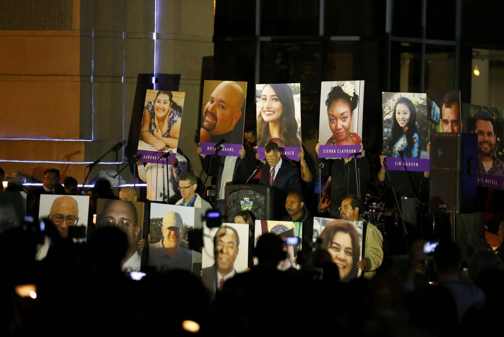 Image: Photos of the victims at San Bernardino vigil
