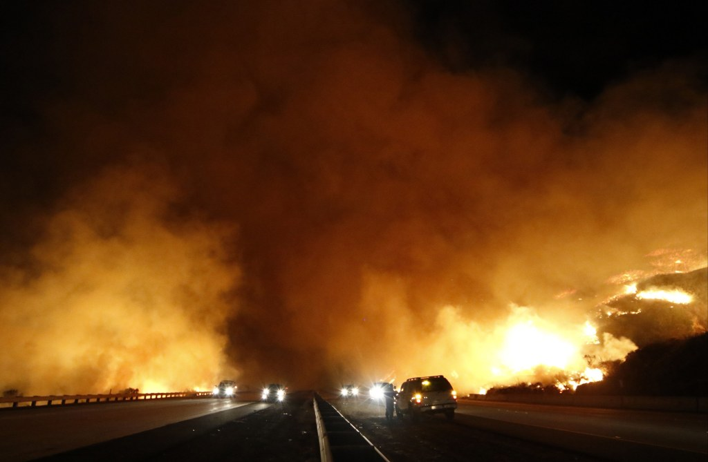 Image: PCH 1 north and south bound lanes are shutdown from the Solimar  brush fire that started early Saturday morning in Ventura County