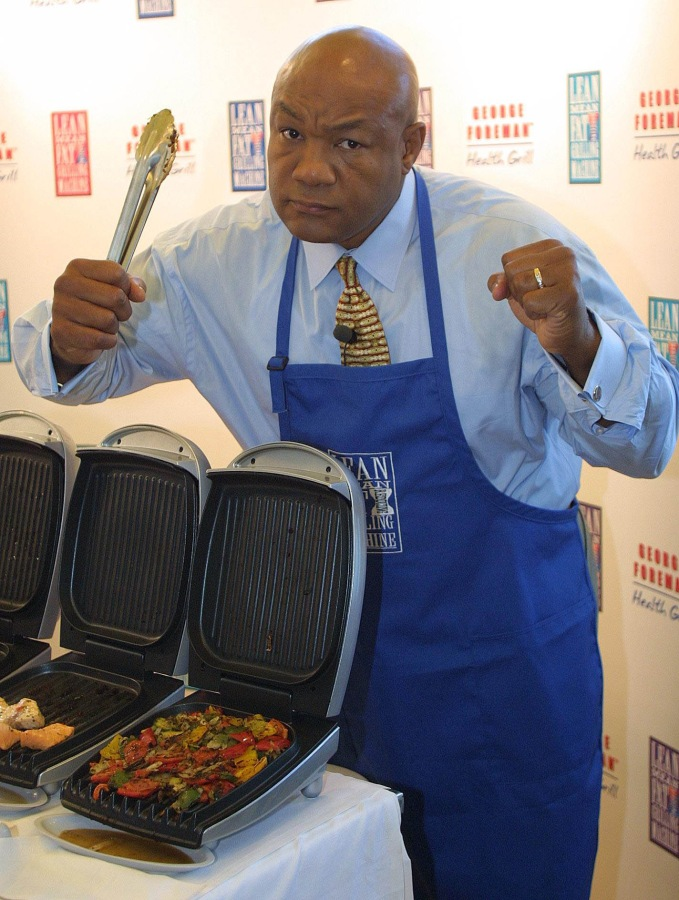 Photo: Former boxing champ George Frazier and his namesake grill.