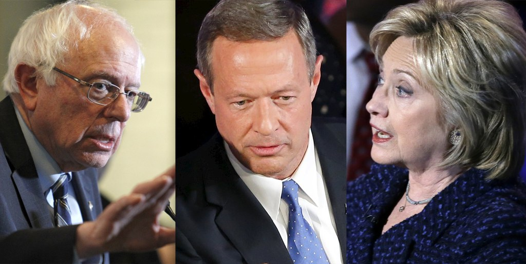 Image: Democratic presidential candidates Bernie Sanders,  Martin O'Malley and Hillary Clinton.