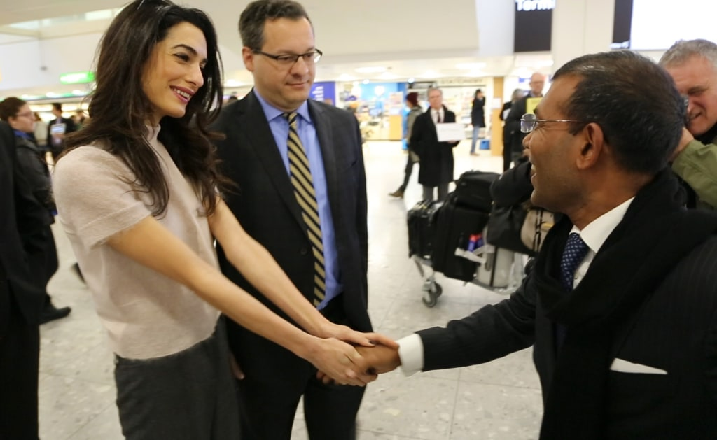 Image: Former Maldives President Nasheed Mohamed is greeted by his attorneys, Amal Clooney and Jared Gender
